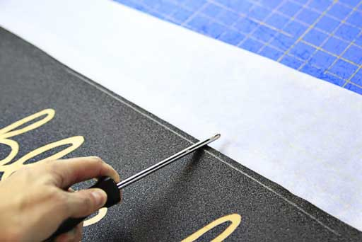 How to apply grip tape to a skateboard and score it via lilblueboo.com #skateboard #diy #gift #handmade