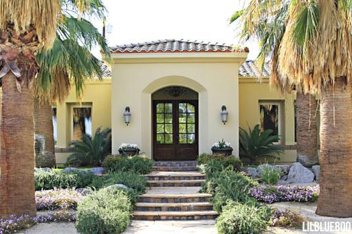 Front walk pavers and stonework - wood divided light - doors were unfinished wood - Desert home design renovation in Palm Desert via Ashley Hackshaw / Lil Blue Boo
