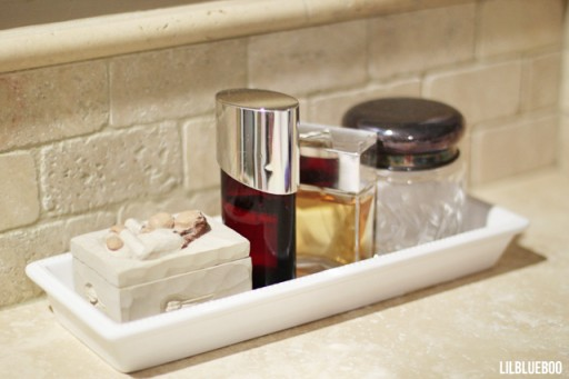 Bathroom organization ideas - corraling clutter - via lilblueboo.com #bathroom #organization