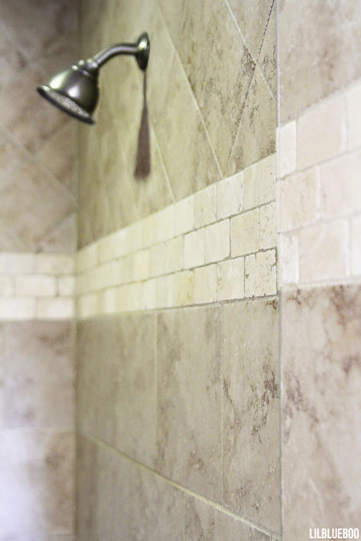 Master Bath - Walk in Shower - tile pattern mixes travertine and ceramic tile for decorating on a budget via lilblueboo.com