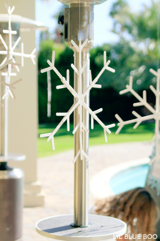 Hang snowflakes made from popsicle sticks for a Frozen Winter Birthday Party via Ashley Hackshaw / lilblueboo.com #frozen