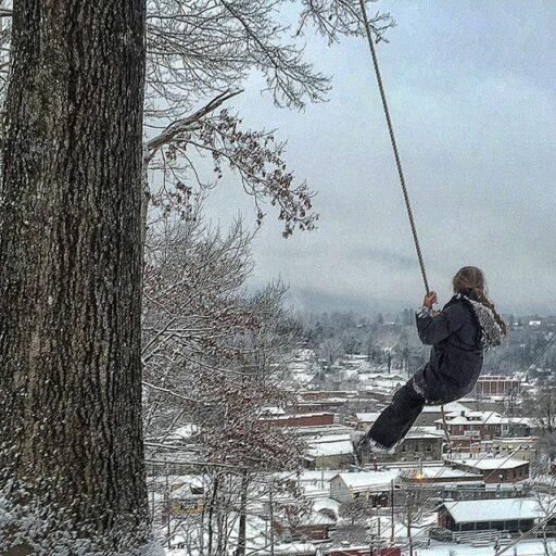 Swinging over downtown Bryson City, NC - original tree swing