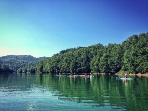 Yoga classes on stand-up paddle boards - Lake Fontana Fingerlake
