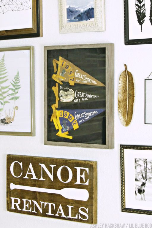 Using a shadow box to display vintage items in a gallery wall