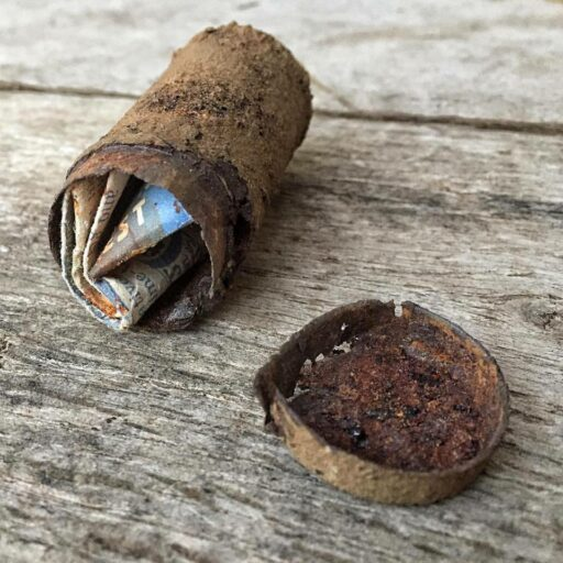 This little metal canister was found in the crawlspace of the house.