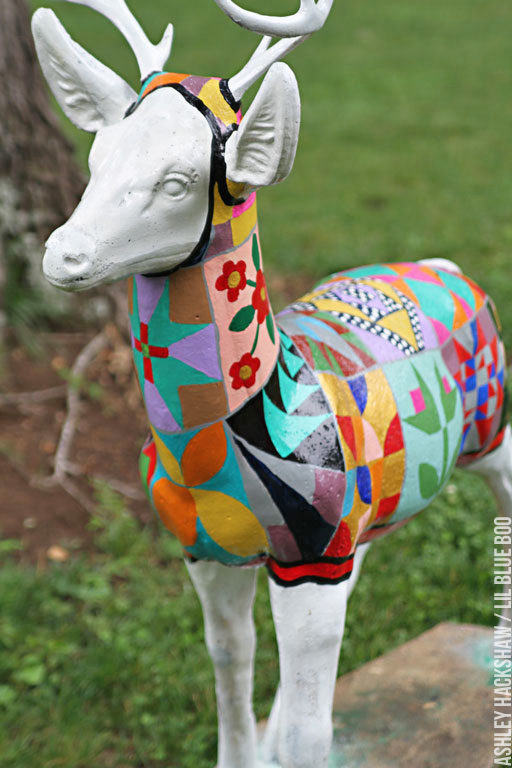 Painting a barn quilt onto a deer statue