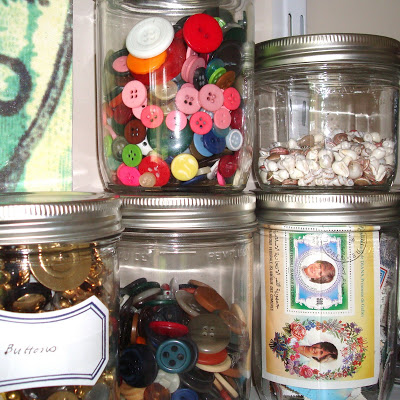 Studio Envy Jars of buttons and stamps via lilblueboo.com