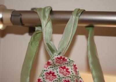 Hand-Sewn Ribbon-Top Curtain Tutorial hanging 1 via lilblueboo.com