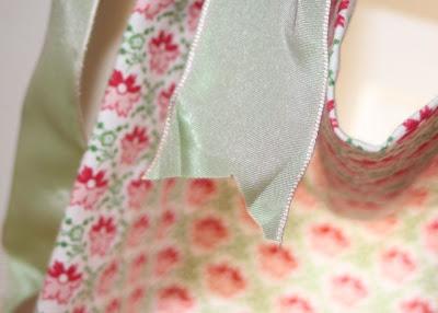 Hand-Sewn Ribbon-Top Curtain Tutorial hanging 4 via lilblueboo.com