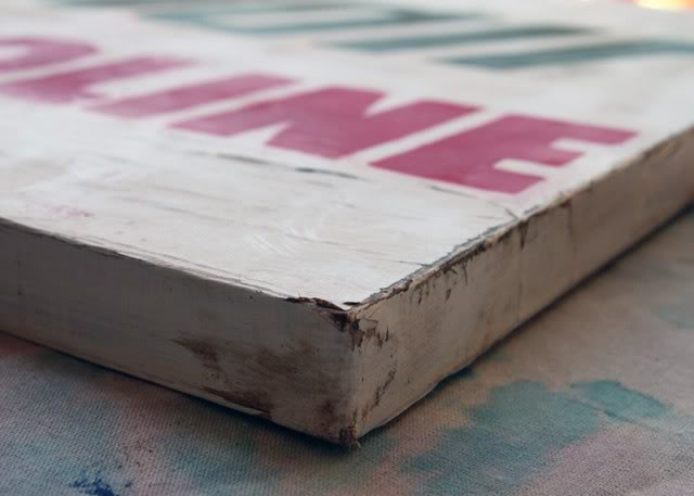 How to make a distressed vintage sign using canvas. DIY tutorial via lilblueboo.com