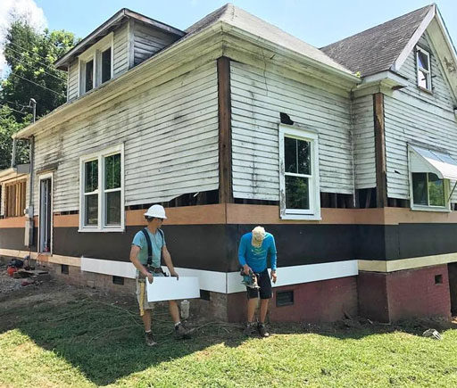 Replacing the Siding on the farmhouse